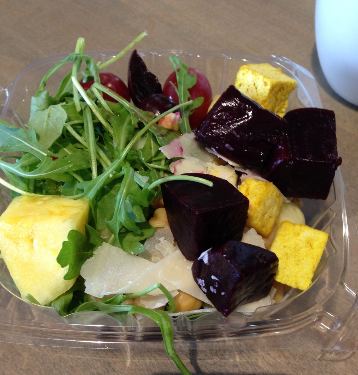 arugula salad with curried tofu, chickpeas, beets, cheese, grapes